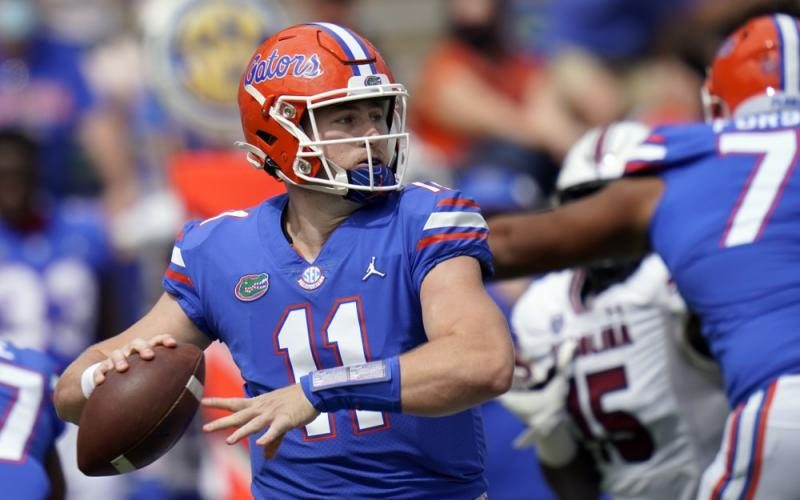 Florida quarterback Kyle Trask (11) throws a pass against South Carolina on Saturday in Gainesville. (JOHN RAOUX/Associated Press)