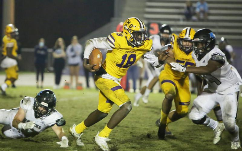 Columbia quarterback Marcus Peterson scrambles up the field against Ponte Vedra during last Friday's Region 1-6A playoff game. (BRENT KUYKENDALL/Lake City Reporter)
