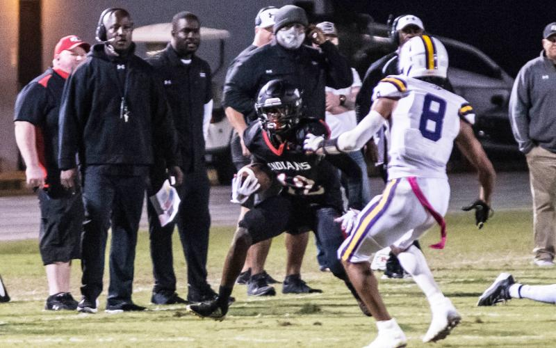 Fort White receiver Najeeb Smith runs up the field after a catch against Union County during Friday's Region 3-1A semifinal. (CHRISTINA FEAGIN/Special to the Reporter)