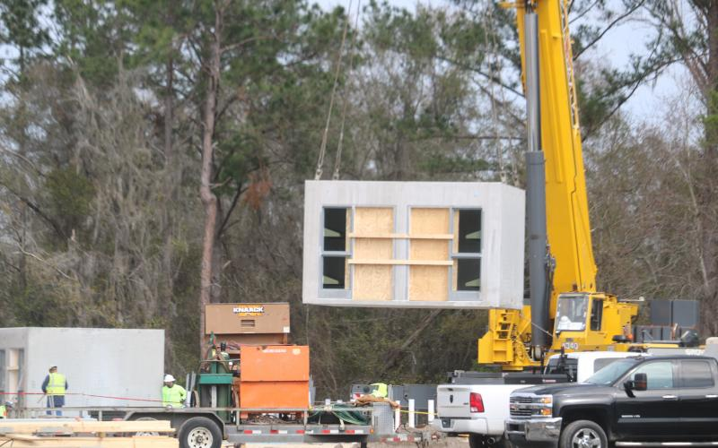 The pre-cast jail cell pods began arriving to the Columbia County Detention Facility this week before being installed with the use of a large crane. (TONY BRITT/Lake City Reporter)