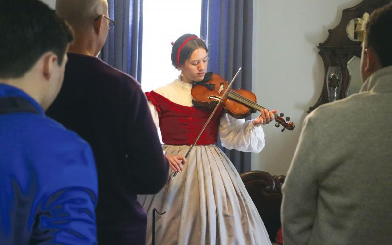 Emily-Jane Curtis, a dual-enrolled student at North Florida Community College, plays Civil War-era songs on her viola during Saturday's 'Blast Through the Past' event at the Lake City-Columbia County Historical Museum. (MORGAN MCMULLEN/Lake City Reporter)